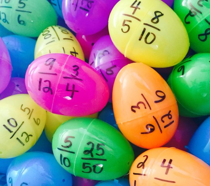 Plastic eggs with equivalent fractions written on each half (Recycling Math Challenges)