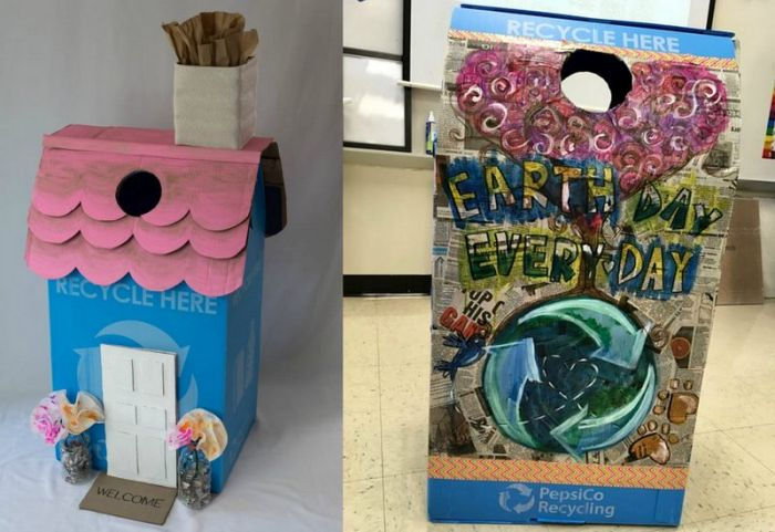 Blue recycling bins decorated with reused materials like newspapers and cardboard