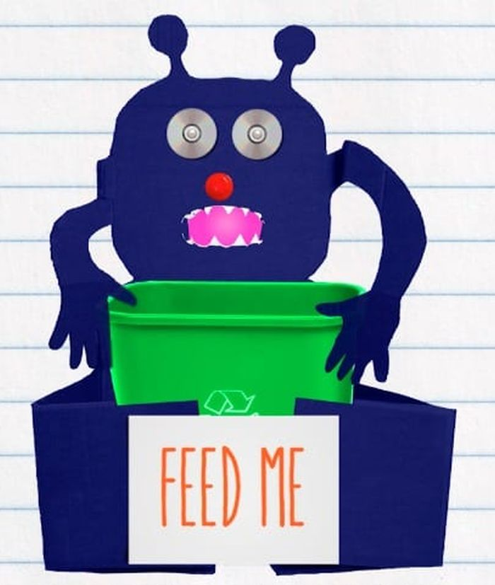 Recycle monster made of cardboard surrounding a recycling bin (Reuse Materials For Art)